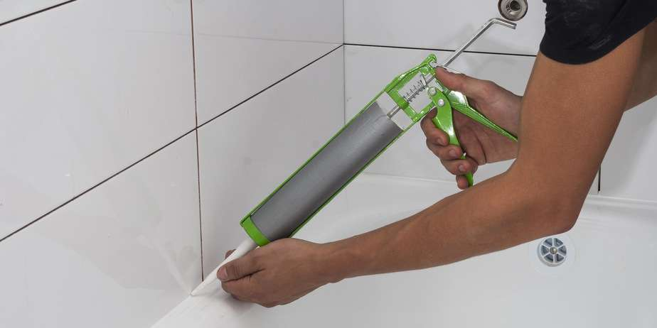 Resealing bath and shower Tray